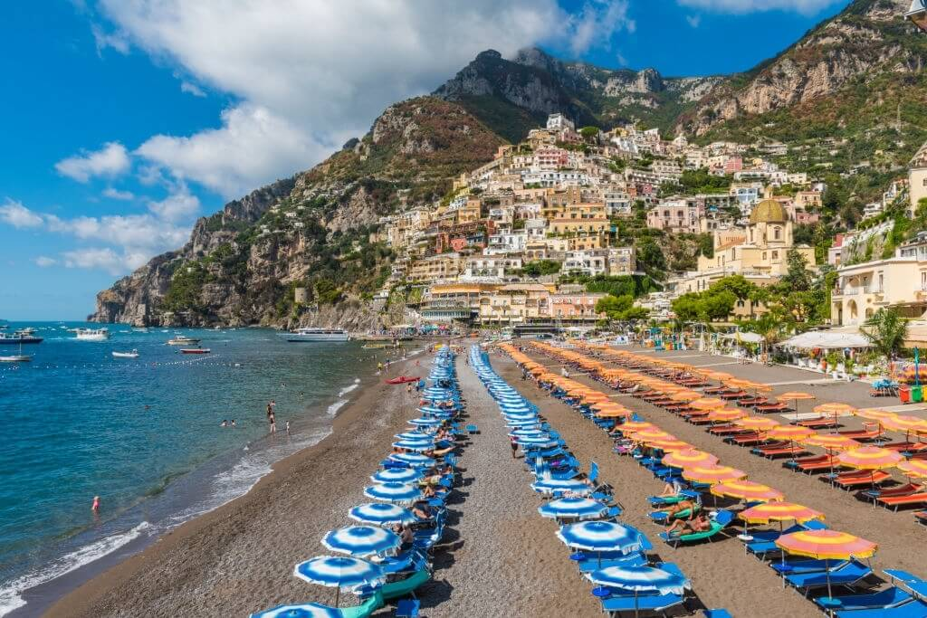 Beach chairs along the water in Positano, The Amalfi Coast